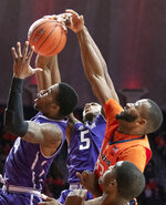 Northwestern forward Vic Law (4) and center Dererk Pardon (5) reach for a rebound against Illinois guard Aaron Jordan (23) during the first half of an NCAA college basketball game in Champaign, Ill., Sunday, March 3, 2019. (AP Photo/Stephen Haas)