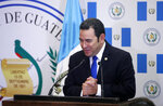 Guatemalan President Jimmy Morales gestures as he speaks during the dedication ceremony of the Guatemala Embassy in Jerusalem, Israel, Wednesday May 16, 2018. (Ronen Zvulun/Pool via AP)