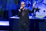 FILE - In this July 2, 2016 file photo, Ringo Starr performs at The Greek Theatre in Los Angeles. Within a week of Paul McCartney playing a surprise show at Grand Central Station, Starr followed a more old-fashioned path Thursday night, Sept. 13, 2018. The 78-year-old drummer and singer headlined a two-hour show at Radio City Music Hall, in New York, with thousands spending much of the performance standing and singing along. (Photo by John Salangsang/Invision/AP, File)