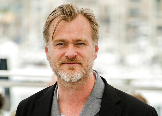 "FILE - In this May 12, 2018, file photo, director Christopher Nolan poses during a photo call at the 71st international film festival in Cannes, southern France. Warner Bros. says it will release Nolan's latest film, the sci-fi espionage spectacle ""Tenet,"