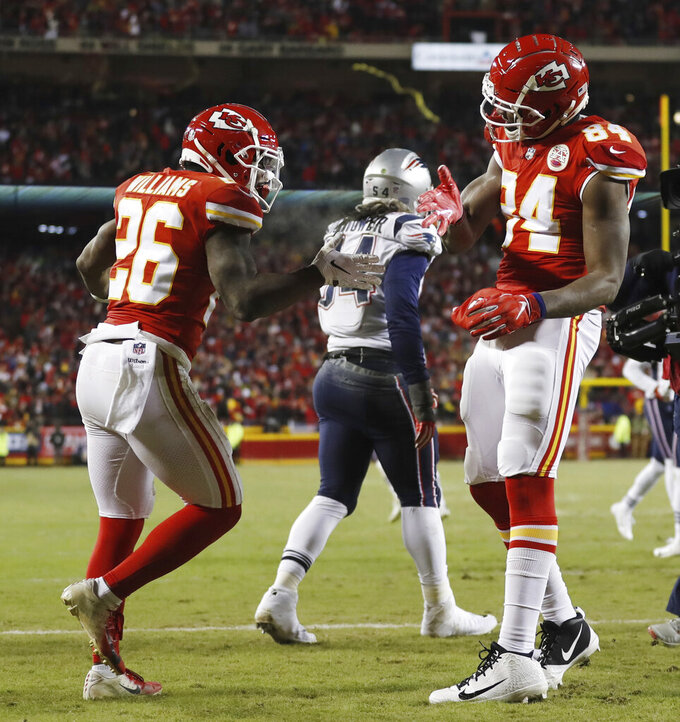 Kansas City Chiefs running back Damien Williams (26) celebrates a touchdown with tight end Demetrius Harris (84) during the second half of the AFC Championship NFL football game, Sunday, Jan. 20, 2019, in Kansas City, Mo. (AP Photo/Jeff Roberson)