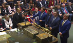 In this grab taken from video on Tuesday, Sept. 3, 2019 Members of Parliament announce the result of a vote for allowing a cross-party alliance to take control of the Commons agenda on Wednesday in a bid to block a no-deal Brexit on October 31 at the House of Commons, in London. (House of Commons/PA via AP)