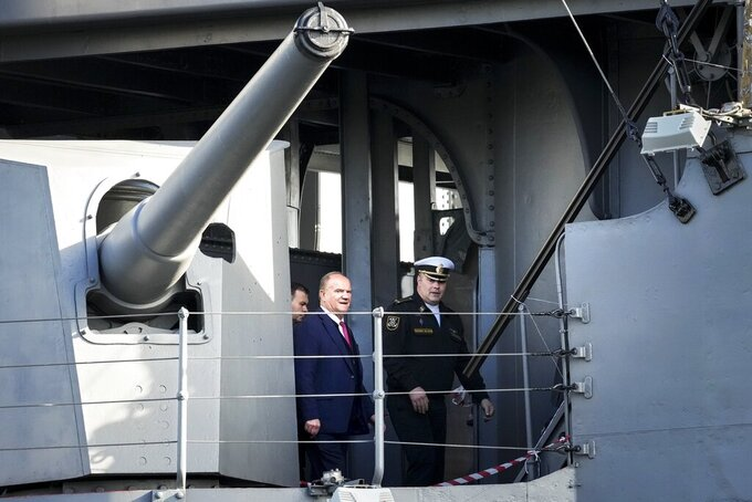 Russian Communist Party leader Gennady Zyuganov, center, visits the historic Aurora cruiser, a symbol of the Bolshevik Revolution of 1917, during a campaign stop in St. Petersburg, Russia, ahead of the election for the State Duma, the lower house of the Russian parliament, on Friday, Sept. 10, 2021. Russia is holding three days of voting that ends on Sunday, Sept. 19, for a new parliament that is unlikely to change the country's political complexion. The Carnegie Moscow Center's prognosis suggests that most of the seats lost by United Russia would be picked up by the Communist Party, the second-largest parliamentary faction. (AP Photo/Dmitri Lovetsky)