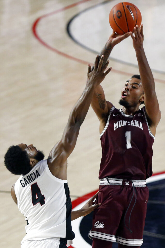 Montana forward Michael Steadman (1) takes a shot over Georgia's Andrew Garcia (4) during an NCAA college basketball game Tuesday, Dec. 8, 2020, in Athens, Ga. (Joshua L. Jones/Athens Banner-Herald via AP)