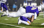 James Madison linebacker Kelvin Azanama (54) tackles Northern Iowa quarterback Will McElvain (13) during the first half of a quarterfinal game in the NCAA college Football Championship Subdivision playoffs in Harrisonburg, Va., Friday, Dec. 13, 2019. (Daniel Lin/Daily News-Record via AP)