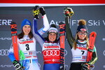 From left, first placed Slovakia's Petra Vlhova, first placed Italy's Federica Brignone and third placed United States' Mikaela Shiffrin celebrate on the podium at the end of an alpine ski, World Cup women's giant slalom in Sestriere, Italy, Saturday, Jan. 18, 2020. Federica Brignone and Petra Vlhova have tied for a World Cup giant slalom victory while overall leader Mikaela Shiffrin finished third by the smallest of margins. (AP Photo/Marco Trovati)