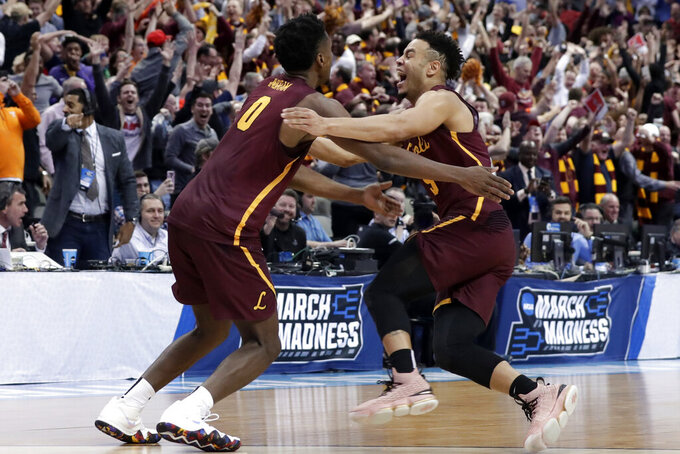 FILE - In this March 15, 2018, file photo, Loyola-Chicago guard Donte Ingram (0) and Marques Townes, right, celebrate their 64-62 win over Miami in a first-round game at the NCAA college basketball tournament in Dallas. Their run to the Final Four as an 11 seed never seemed short of drama.(AP Photo/Tony Gutierrez, File)