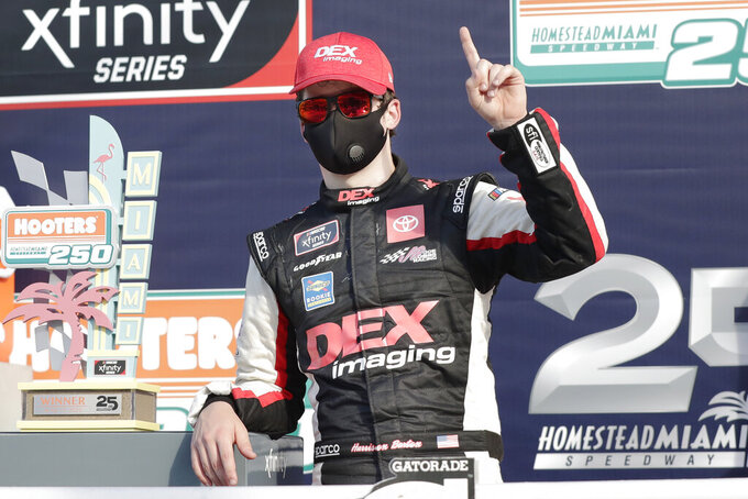 Harrison Burton celebrates after winning a NASCAR Xfinity Series auto race Saturday, June 13, 2020, in Homestead, Fla. (AP Photo/Wilfredo Lee)