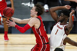 Utah's Mikael Jantunen (20) shoots around Southern California's Chevez Goodwin (1) during the first half of an NCAA college basketball game in the quarterfinal round of the Pac-12 men's tournament Thursday, March 11, 2021, in Las Vegas. (AP Photo/John Locher)