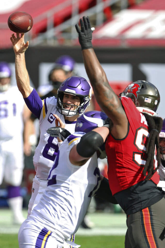 Minnesota Vikings quarterback Kirk Cousins (8) throws a pass as he is pressured by Tampa Bay Buccaneers nose tackle Steve McLendon (96) during the first half of an NFL football game Sunday, Dec. 13, 2020, in Tampa, Fla. (AP Photo/Mark LoMoglio)