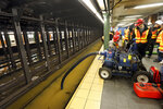 Workers pump out the flooded Lincoln Center subway station, in New York, Monday, Jan. 13, 2020. A water main break flooded streets on Manhattan's Upper West Side near Lincoln Center and hampered subway service during the Monday morning rush hour. (AP Photo/Richard Drew)