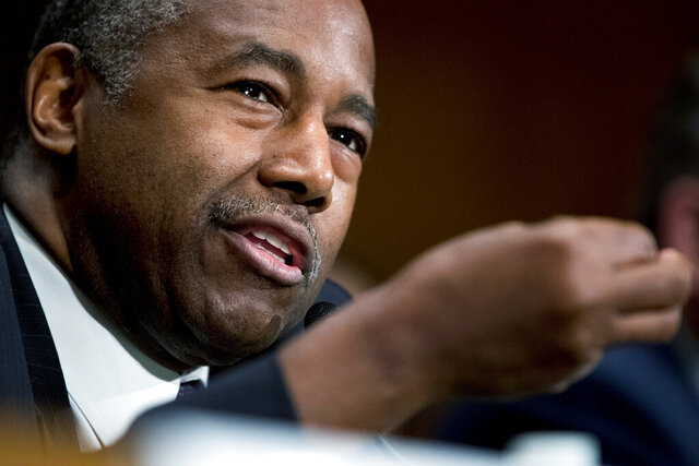 FILE - In this Sept. 10, 2019 file photo, Housing and Urban Development Secretary Ben Carson speaks at a Senate Banking Committee hearing on