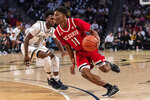 North Carolina State guard Markell Johnson (11) drives past Georgia Tech guard Bubba Parham (11) in the second half of an NCAA college basketball game Saturday, Jan. 25, 2020, in Atlanta. Georgia Tech won 64-58. (AP Photo/Danny Karnik)