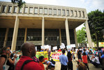 People hold a rally outside the Federal Courthouse in Bridgeport, Conn. on Wednesday, July 11, 2018. Lawyers for two immigrant children detained in Connecticut after being separated from their parents at the U.S.-Mexico border asked a federal judge on Wednesday to order that the girl and boy be reunited with their families.  (Brian A. Pounds/Hearst Connecticut Media via AP)