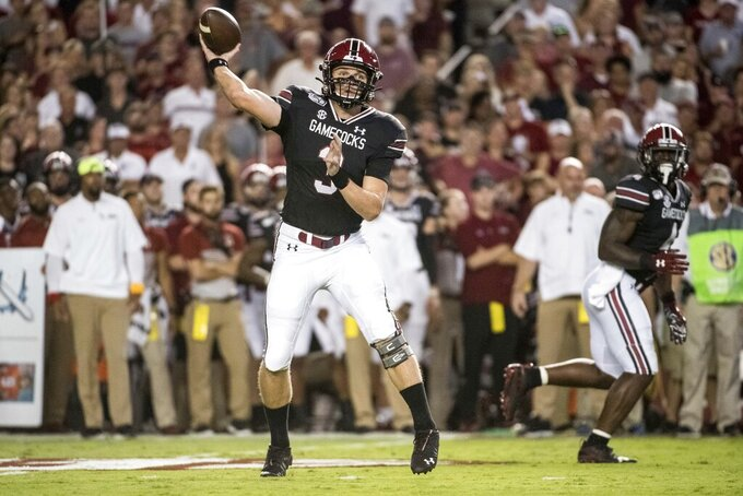 South Carolina quarterback Ryan Hilinski (3) attempts a pass against Kentucky during the first half of an NCAA college football game Saturday, Sept. 28, 2019, in Columbia, S.C. (AP Photo/Sean Rayford)