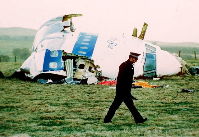 FILE  - In this, Wednesday, Dec. 21, 1988 file photo, a police officer walks by the nose of Pan Am flight103 in a field near the town of Lockerbie, Scotland where it lay after a bomb aboard exploded, killing a total of 270 people. The family of a Libyan convicted in the Lockerbie bombing has lost an appeal in a court in Scotland on Friday, Jan. 15, 2021 to have his conviction overturned posthumously.  Abdelbaset al-Megrahi was found guilty in 2001 of mass murder for the attack on Pan Am flight 103, which was traveling from London to New York on Dec. 21, 1988.  The bombing killed all 259 people aboard the plane and another 11 on the ground. Al-Megrahi was jailed for life, but the family of the former intelligence officer has long claimed his innocence. They plan to appeal to the U.K. Supreme Court. (AP Photo/Martin Cleaver, File)
