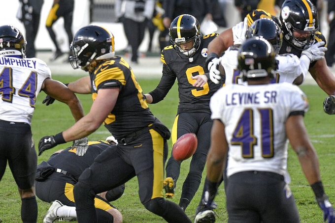Pittsburgh Steelers kicker Chris Boswell (9) hits a field goal against the Baltimore Ravens during the first half of an NFL football game, Wednesday, Dec. 2, 2020, in Pittsburgh. (AP Photo/Don Wright)