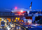 FILE - In this Friday, Sept. 20, 2019 file photo an aircraft crosses a bridge over a highway the airport in Frankfurt, Germany.(AP Photo/Michael Probst, File)