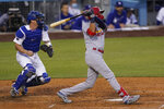 St. Louis Cardinals' Dylan Carlson (3) hits a home run during the sixth inning of a baseball game against the Los Angeles Dodgers Monday, May 31, 2021, in Los Angeles. (AP Photo/Ashley Landis)