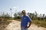 Joe Leonard stands on his property in Blounstown, Fla. The family's timber business was devastated by Hurricane Michael a year ago. The massive storm killed more than two dozen people in northern Florida, destroyed hundreds of homes and brought catastrophic damage to the region's timber industry.  (AP Photo/Bobby Caina Calvan)