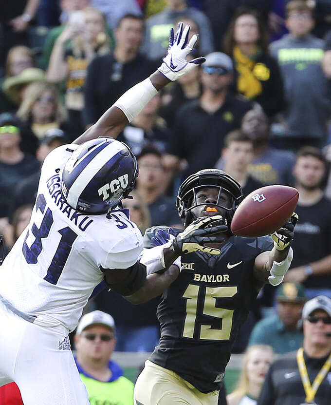 TCU safety Ridwan Issahaku (31) breaks up the pass intended for Baylor wide receiver Denzel Mims (15) in the final seconds in second half of an NCAA college football game Saturday, Nov. 17, 2018. (Jerry Larson/Waco Tribune-Herald via AP)