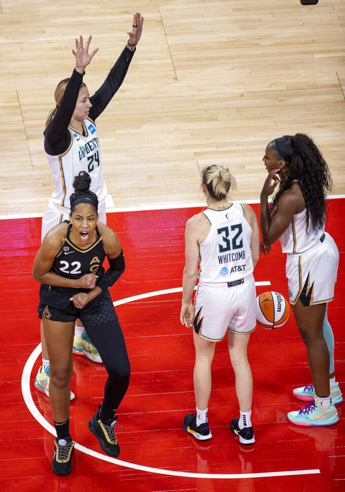 Las Vegas Aces forward A'ja Wilson (22) is pumped up after a score and a foul by New York Liberty forward Kylee Shook (24) during the first quarter of a WNBA basketball game Thursday, June 17, 2021, in Las Vegas. (L.E. Baskow/Las Vegas Review-Journal via AP)