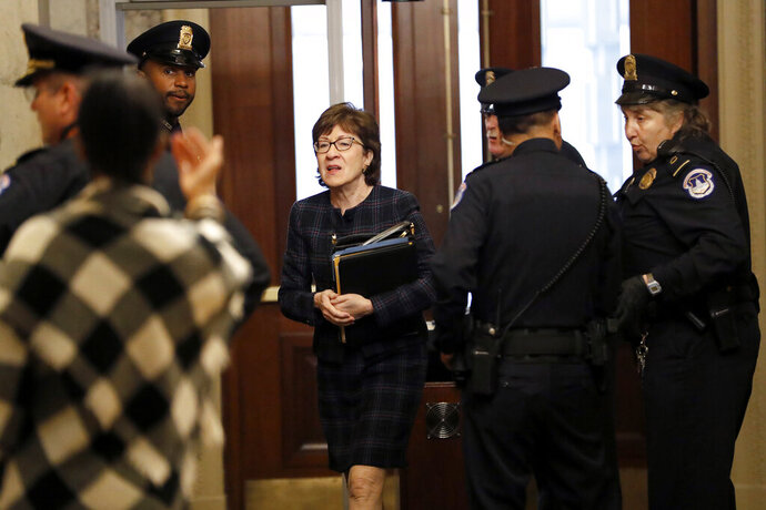 Sen. Susan Collins, R-Maine, arrives at the Capitol in Washington during the impeachment trial of President Donald Trump on charges of abuse of power and obstruction of Congress, Thursday, Jan. 23, 2020. (AP Photo/Julio Cortez)