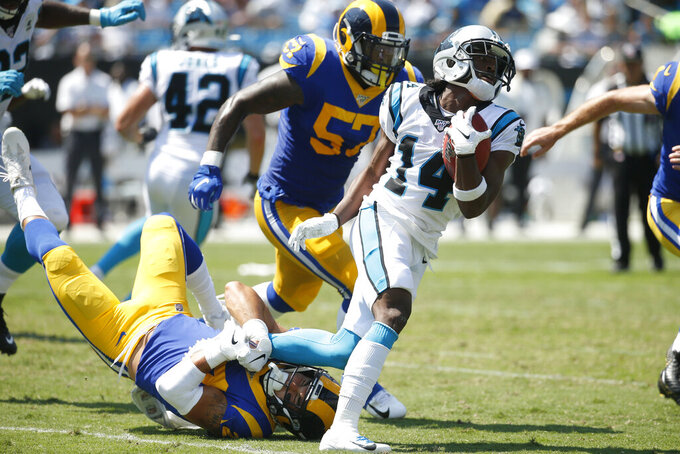 Los Angeles Rams safety Taylor Rapp (24) reaches to tackle Carolina Panthers wide receiver Ray-Ray McCloud (14) during the first half of an NFL football game in Charlotte, N.C., Sunday, Sept. 8, 2019. (AP Photo/Brian Blanco)
