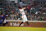 Atlanta Braves' Dansby Swanson hits in the third inning of a baseball game against the Los Angeles Dodgers, Saturday, June 5, 2021, in Atlanta. (AP Photo/Brynn Anderson)