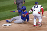 Chicago White Sox third baseman Yoan Moncada, right, tags out Chicago Cubs' David Bote at third during the sixth inning of a baseball game in Chicago, Sunday, Sept. 27, 2020. (AP Photo/Nam Y. Huh)