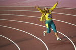 Kelsey-Lee Barber, of Australia, celebrates winning a gold medal in the women's javelin throw final at the World Athletics Championships in Doha, Qatar, Tuesday, Oct. 1, 2019. (AP Photo/Martin Meissner)