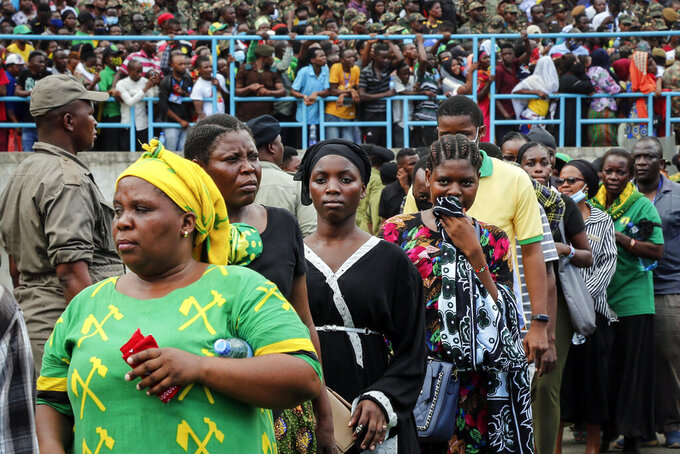 Mourners queue to pay their respects as the body of former president John Magufuli lies in state at Uhuru stadium in Dar es Salaam, Tanzania Saturday, March 20, 2021. Magufuli, a prominent COVID-19 skeptic whose populist rule often cast his country in a harsh international spotlight, died Wednesday aged 61 of heart failure, it was announced by Vice President Samia Suluhu Hassan, who was sworn-in as the country's new president on Friday. (AP Photo)