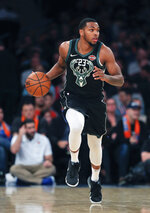 FILE - In this Dec. 1, 2018, file photo, Milwaukee Bucks guard Sterling Brown (23) brings the ball up court against the New York Knicks during the fourth quarter of an NBA basketball game, in New York. The Bucks guard insists he long moved forward from the ordeal, during which he felt use of a stun gun was excessive and that he was targeted because he's black. As a professional athlete, that's what he gets paid to do: Let go of the failures and tough moments in a hurry. On to the next city, the next game. A new challenge. (AP Photo/Julie Jacobson, File)