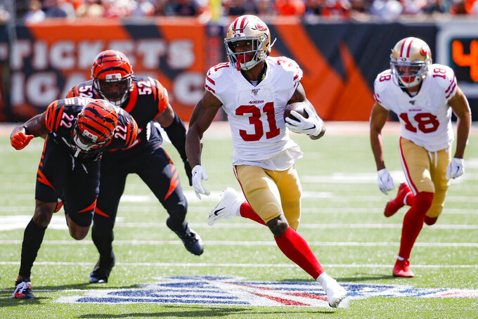 San Francisco 49ers running back Raheem Mostert (31) runs the ball for a touchdown during the first half an NFL football game against the Cincinnati Bengals, Sunday, Sept. 15, 2019, in Cincinnati. (AP Photo/Frank Victores)