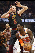New York Knicks' Julius Randle (30) tries to get past Cleveland Cavaliers' Kevin Love (0) in the second half of an NBA basketball game, Monday, Jan. 20, 2020, in Cleveland. New York won 106-86. (AP Photo/Tony Dejak)
