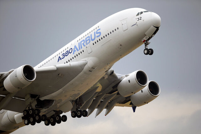 FILE - In this June 18, 2015, file photo, an Airbus A380 takes off for its demonstration flight at the Paris Air Show in Le Bourget airport, north of Paris. Airbus says it has reached potential settlement agreements with financial investigators in the U.S., Britain and France. British and French authorities are investigating alleged fraud and bribery related to Airbus' use of outside consultants to sell planes. (AP Photo/Francois Mori, File)
