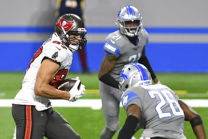 Tampa Bay Buccaneers tight end Rob Gronkowski (87) watches as Detroit Lions strong safety Duron Harmon (26) closes in during the second half of an NFL football game, Saturday, Dec. 26, 2020, in Detroit. (AP Photo/Lon Horwedel)