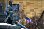 FILE - In this file photo taken on Friday, Dec. 30, 2016, The U.S. Embassy with its national flag, seen behind a monument to the Workers of 1905 Revolution in Moscow, Russia. Russian Foreign Minister Sergey Lavrov says Moscow will order 10 U.S. diplomats to leave Russia in a retaliatory response to the U.S. sanctions. Lavrov also said Moscow will add eight U.S. officials to its sanctions list and move to restrict and stop the activities of U.S. nongovernmental organizations from interfering in Russia's politics. (AP Photo/Alexander Zemlianichenko, File)