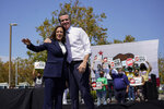 Vice President Kamala Harris stands on stage with California Gov. Gavin Newsom at the conclusion of an event at the IBEW-NECA Joint Apprenticeship Training Center in San Leandro, Calif., Wednesday, Sept. 8, 2021. (AP Photo/Carolyn Kaster)