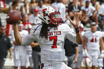 Texas Tech quarterback Jett Duffey (7) throws in the fourth quarter of an NCAA college football game against Oklahoma in Norman, Okla., Saturday, Sept. 28, 2019. (AP Photo/Sue Ogrocki)