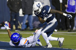 Utah State cornerback DJ Williams, right, throws Boise State wide receiver John Hightower to the ground after the play was over during the first half of an NCAA college football game Saturday, Nov. 23, 2019, in Logan, Utah. Both players received an unsportsmanlike-conduct penalty; it was Williams' second of the game and he was ejected. (AP Photo/Eli Lucero)