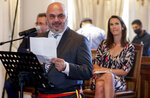 Mayor of Ixelles Christos Doulkeridis, left, speaks during celebrations marking the 60th anniversary of Congo's independence from Belgium in the Brussels district of Matonge, Tuesday, June 30, 2020. (Stephanie Lecocq, Pool Photo via AP)