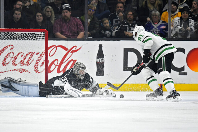 Los Angeles Kings goaltender Jonathan Quick, left, stops a shot by Dallas Stars center Tyler Seguin during the second period of an NHL hockey game Wednesday, Jan. 8, 2020, in Los Angeles. (AP Photo/Mark J. Terrill)