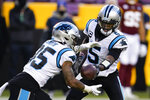 Carolina Panthers quarterback Teddy Bridgewater (5) hands the ball off to running back Rodney Smith (35) during the first half of an NFL football game, Sunday, Dec. 27, 2020, in Landover, Md. (AP Photo/Mark Tenally)