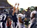 Connecticut quarterback Mike Beaudry (12) celebrates after scoring a touchdown against Wagner during the first half of an NCAA college football game Thursday, Aug. 29, 2019, in East Hartford, Conn. (AP Photo/Stephen Dunn)