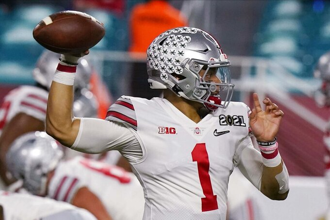 Ohio State quarterback Justin Fields warms up before an NCAA College Football Playoff national championship game against Alabama, Monday, Jan. 11, 2021, in Miami Gardens, Fla. (AP Photo/Lynne Sladky)