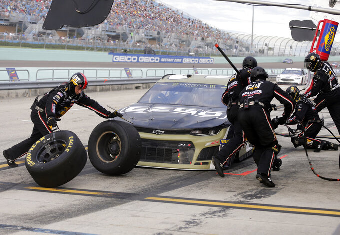Ryan Newman makes a pit stop during the NASCAR Cup Series Championship auto race at the Homestead-Miami Speedway, Sunday, Nov. 18, 2018, in Homestead, Fla. (AP Photo/Terry Renna)