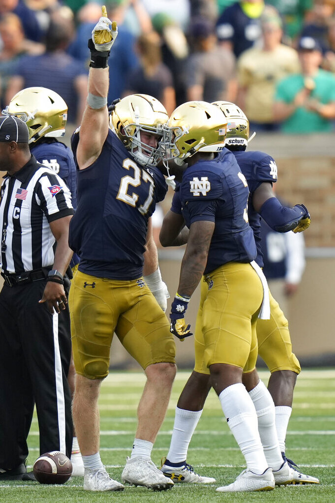 Notre Dame linebacker JD Bertrand (27) celebrates making a fumble recovery against Toledo in the second half of an NCAA college football game in South Bend, Ind., Saturday, Sept. 11, 2021. Notre Dame won 32-29. (AP Photo/AJ Mast)