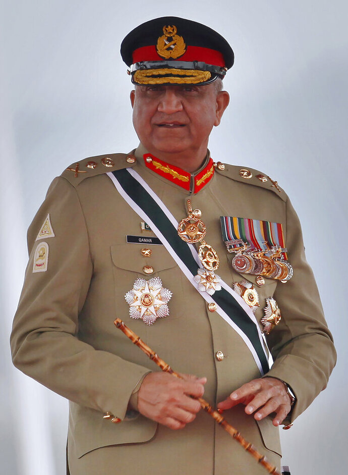 FILE - In this March 23, 2019, file photo, Pakistan's Army Chief Gen. Qamar Javed Bajwa attends a military parade in Islamabad, Pakistan. Pakistan's army chief Tuesday, Oct. 20, 2020, ordered an investigation into allegations that a provincial police chief was kidnapped by army troops to force him to order the arrest of the son-in-law of exiled former prime minister Nawaz Sharif. (AP Photo/Anjum Naveed, File)