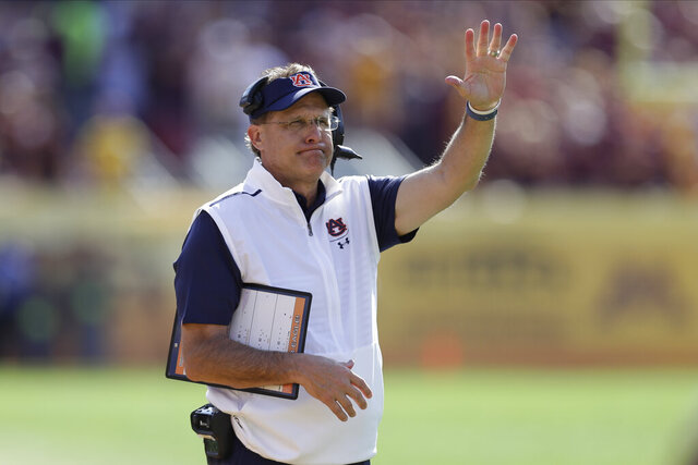 FILE - In this Jan. 1, 2020, file photo, Auburn head coach Gus Malzahn directs his team during the Outback Bowl NCAA college football game against Minnesota in Tampa, Fla. Auburn spokesman Kirk Sampson confirmed that Auburn hadn't practiced Wednesday or Thursday as scheduled. (AP Photo/Chris O'Meara, File)